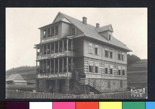 b&w photo of a wooden three-story home with girls lining the balcony